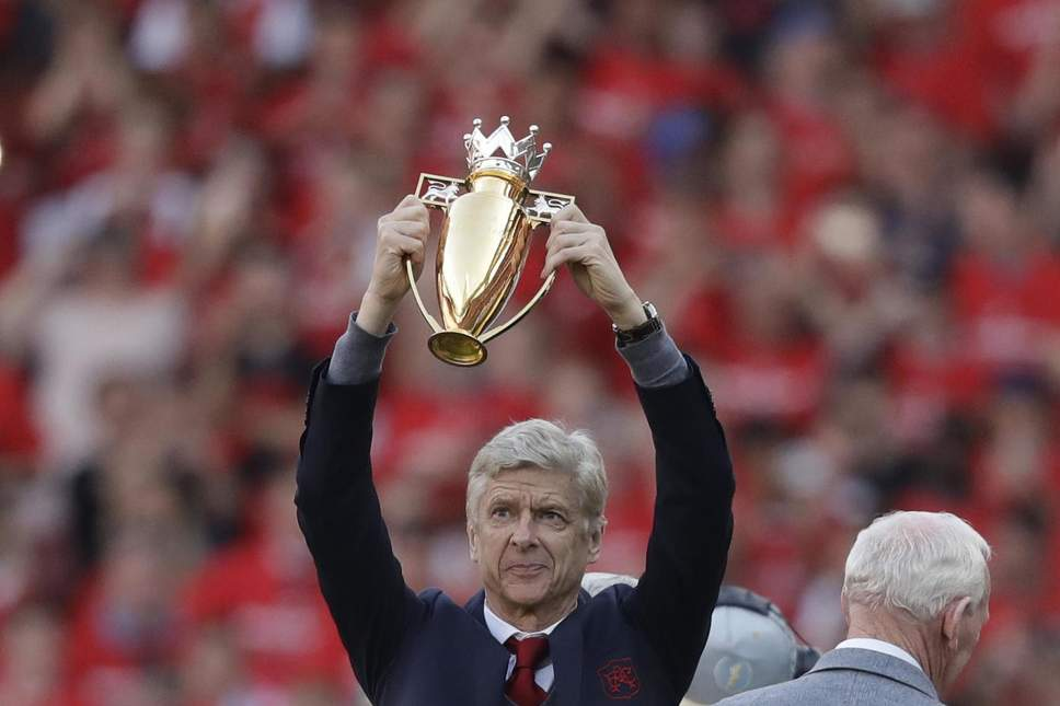 190940550-arsenal27s-french-manager-arsene-wenger-holds-a-trophy-he-was-presented-with-after-t...jpg